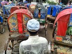 Wet Shirt (AvikBangalee) Tags: wet rain weather shirt traffic lifestyle baseballhat cap dhaka rickshaw bangladesh rickshawart rickshawpuller elephantroad flickrandroidapp:filter=none