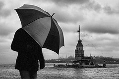 Rain Man  Turkey - Istanbul (bahadırbermekphotography) Tags: street city travel sea portrait people blackandwhite bw cloud white abstract tower art nature wet water monochrome rain weather silhouette horizontal architecture composition umbrella work canon turkey outdoors photography town interestingness model day photographer adult geometry snapshot transport perspective citylife streetphotography photojournalism documentary streetscene scene istanbul views historical streetphoto rearview tempest capture protection oneperson distant photojournalist photooftheday sokak sahil maidenstower kızkulesi casualclothing standingwater travelphoto obscuredface arthitecture onemanonly waistup abigfave builtstructure slicesoftime istanbullovers