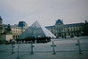 Musée du Louvre (Melissa O'Donohue) Tags: travel paris france art film rain museum vintage dark french europe pretty gloomy pyramid crowd 2006 tourists disposablecamera visitors impei traveler luvre muséedulouvre