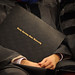 A fresh, new degree rests comfortably in the hands of a graduate during commencement.