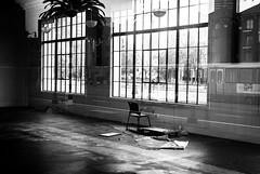 front row interlude (Super G) Tags: sanfrancisco california blackandwhite bw building abandoned window reflections pier chair ghost bayarea singleexposure