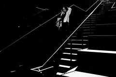 Enter The TRON.. (Peter Levi) Tags: street city urban blackandwhite bw woman blancoynegro stairs contrast 35mm lights shadows sweden stockholm streetphotography documentary socialdocumentary x100 stripedshadows x100fujifilm