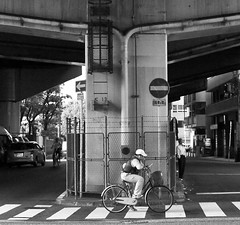 Pause (Aaron Webb) Tags: bw bicycle japan underpass cellphone   osaka crosswalk
