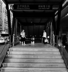 Two women at the exit  (wee_photo) Tags: street blackandwhite bw taiwan snap wee taipei mrt    ricoh    grd grd3