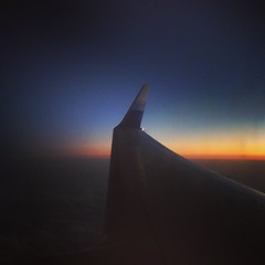 Let's go home (Greenyoti) Tags: sunset sky skyline clouds plane wing gradation