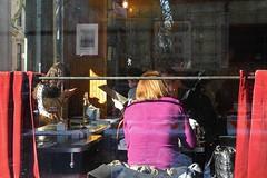 red velvet curtain (omoo) Tags: newyorkcity girls sunlight window glass self reflections menu restaurant phone westvillage cell streetscene bistro greenwichvillage tartine frenchbistro purpleandred redvelvetcurtain dscn8013