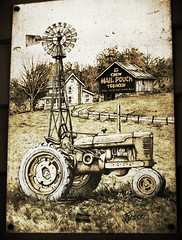 tractorprint on the wall at Bart's Bait (LauraSorrells) Tags: tractor sign rural georgia july southern faded fade summertime 2008 smalltown muted talkingrock funkiness bartsbaitshop