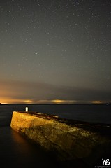 Starry Pier (Kyle Simpson) Tags: ocean sky cloud water night clouds 35mm lights scotland pier nikon nightsky nikkor starry moray stargazing morayshire portknockie starrysky d3100 starrypier