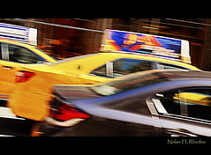 """Taxis and Autos Streaking Down Fifth Avenue NYC (nrhodesphotos(the_eye_of_the_moment)) Tags: nyc red signs motion black cars window glass yellow reflections shadows artistic perspective creative taxis transportation autos fifthavenue treatment redtaillights dsc0958 nrhodesphotosyahoocom """"theeyeofthemomentphotosbynolanhrhodes"""""""