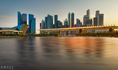 BaySide (draken413o) Tags: travel light sunset urban panorama skyline architecture marina bay singapore asia cityscapes shift places tilt extender destinations 17mm