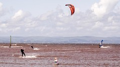 Kitesurfers, Windsurfer and lady rescuing kids beach ball (Gidzy) Tags: summer kite seaside surfer surfing kitesurfing lancashire windsurfing british morecambe irishsea morecambebay morecambebaysurfingclub