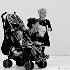 In the Museum (Akbar Simonse) Tags: holland netherlands nederland museum people candid woman children wandelwagen stroller zwartwit bw blancoynegro bn monochrome streetphotography streetshot straatfotografie straatfoto vierkant square akbarsimonse iljarepin russianrealism assen girls kids childwheels