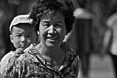 Smiles (Worth_Wondering) Tags: china travel red blackandwhite bw white black love smile wall canon children mom temple worship shrine asia child mark religion beijing culture romance altar 5d traveling 60d