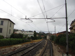May 17, 2013 (the brilliant magpie) Tags: trip railroad travel vacation sky italy lake storm rain clouds train dark lago town italia gray tracks rail umbria trasimeno passignano