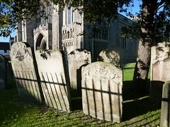 King's Lynn Minster: gravestones in churchyard with shadow of railings (John Steedman) Tags: uk greatbritain england unitedkingdom norfolk lynn kings gravestone churchyard minster gravestones kingslynn grossbritannien   grandebretagne