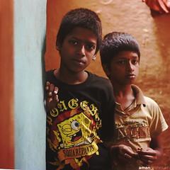 Curiosity at the doorstep. (Aman Deshmukh) Tags: portrait india kids children child bangalore photojournalism right cry curiosity madivala childrights childrightsandyou