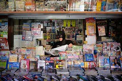 "170/365 - ""I'm Batman"" nr.20 - EXPLORED - Aug 1, 2013 #60 (Luca Rossini) Tags: portrait news man guy shop project comics reading blog sitting sony newspapers 365 magazines seller newsagent imbatman rx1 365daysofrx1onecameraonelens12projects"