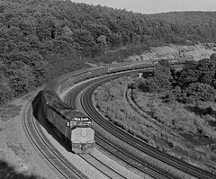 "Amtrak ""National Limited"" at Bennington Curve, near Tunnel Hill, Pennsylvania, 1973 (Ivan S. Abrams) Tags: blackandwhite newcastle pittsburgh butler bo ge prr ble conrail alco milw emd ple 2102 chessiesystem westmorelandcounty 4070 bessemerandlakeerie steamtours pittsburghandlakeerie ivansabrams eidenau steamlocomtives ustrainsfromthe1960sand1970s"