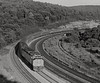 "Amtrak ""National Limited"" at Bennington Curve, near Tunnel Hill, Pennsylvania, 1973 (Ivan S. Abrams) Tags: blackandwhite newcastle pittsburgh butler bo ge prr ble conrail alco milw emd ple 2102 chessiesystem westmorelandcounty 4070 bessemerandlakeerie steamtours pittsburghandlakeerie ivansabrams eidenau steamlocomtives ustrainsfromthe1960sand1970s"