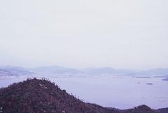 (Kkeina) Tags: sea mountains film nature japan analog 35mm island 50mm olympus hiroshima miyajima manual om om1 sku