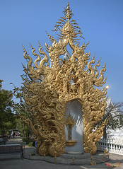 Wat Rong Khun Golden Flame (DTHCR0058)   (Gerry Gantt Photography) Tags: thailand temple scenic wat  watrongkhun chiangraiprovince  thewhitetemple totallythailand  thailand   chiangraiprovince chiangraiprovince tambonpatankhuntandistrict tambonpatankhuntandistrict tambonpatan khuntandistrict