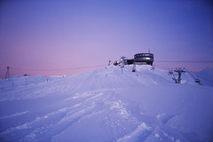 (xbacksteinx) Tags: morning winter sky mountains film analog sunrise 35mm snowboarding switzerland early mood moody slide laax expiredfilm pointnshoot kodakelitechrome olympusmjuii crapsogngion