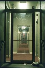 the ongoing door series (LilaRae) Tags: portland door film 35mm ilikedoors doorway glass apartments city