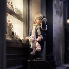 Warsaw (iwona_podlasinska) Tags: child window street hat toy toys light