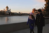 Russian couple walking by the Moskva