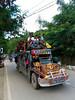 Jeepney Philippines_0419 (ichauvel) Tags: jeepney vehicule bus transportencommun moyendetransport gens people hommes men femmes women coloré coloured rue street rouler exterieur outside végétation philippines corongcorong palawan ile voyage travel