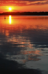 Setting Sun Ignites Horizon (LostMyHeadache: Absolutely Free *) Tags: sunset summer sky sun motion nature water silhouette clouds canon reflections evening twilight waves glow dusk horizon explosion ripples fiery settingsu