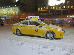 Taxi cab yellow car in New York City, USA during winter snow storm (RYANISLAND) Tags: nyc newyorkcity usa snow ny newyork storm cold weather america 14 snowstorm freezing american timessquare snowing storms wintersnow coldweather northeast extremeweather winterstorm noreaster winterweather 2014 snowstorms weatherstorm winterstormhercules