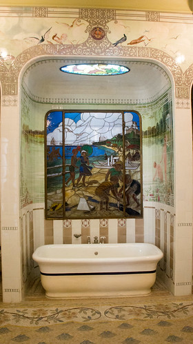 The bath tub and stained glass in the Palace