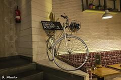 Interior decoration in a color bar (A. Muiña) Tags: decoración decoracióninterior bicicleta bar callejera street urbana cosa objeto photography ricoh angular object