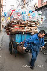 Recycling at work (10b travelling) Tags: 10btravelling 2016 asia asie asien beijing carstentenbrink china chine chinese dongcheng iptcbasic pet prc peking peoplesrepublicofchina capital cardboard cart city collection environment man plasticbottles pulling recycling removal sustainability tenbrink 东城区 中华人民共和国 中国 北京市