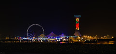 the tower & the wheel (r4ramzan) Tags: uae marina mall dusk twilight lowkey long exposure night beach seaside giant wheel lights sky
