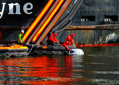 Scotland Greenock the ship repair dock ship evacuation drill car ferry Clansman a ship inspector watches as crewmen inflate a liferaft 24 February 2017 by Anne MacKay (Anne MacKay images of interest & wonder) Tags: scotland greenock ship repair dock evacuation drill caledonian macbrayne car ferry clansman crewmen liferaft xs1 24 february 2017 picture by anne mackay
