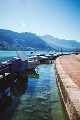 By the Lake of Annecy () Tags: trip travel blue light summer vacation sky mountain lake france color reflection green annecy nature water june landscape outside outdoors daylight boat cool dock colorful europe day peace pentax calm fresh 2012 lacdannecy hautesavoie k7 rhnealpes 1770mm