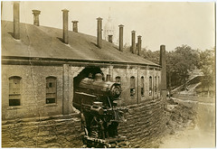 [New York, New Haven and Hartford Locomotive No. 321 crash through roundhouse] (SMU Central University Libraries) Tags: newyork train vintage vehicle newhaven railways steamengine railcars locomotives railroads crashes roundhouses monomonday