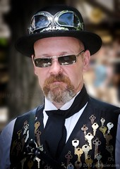 The Keymaster (Jim Frazier) Tags: costumes summer portrait people usa fashion festival wisconsin pose ties bristol keys glasses clothing eyecontact cosplay caps goggles victorian culture hats july posed fair equipment fantasy portraiture faire characters inventions vest vests costuming goggle wi renaissance bristolrenaissancefaire fayre edwardian q3 apparatus roles renaissancefair devices steampunk kenosha v500 bristolrenaissancefair eyetoeye 2013 5000people ldjuly ©jimfraziercom adifferentpersona ld2013 20130700bristol 20130720bristol