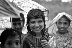 Sri Lanka (luca marella) Tags: street girls boy portrait people blackandwhite black film boys wet water girl face rain analog umbrella blackwhite asia documentary social pb bn bianco reportage marellaluca