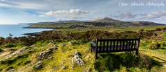 Maughold, Isle of Man (Heathcliffe2) Tags: ocean sea grass bench landscape view seat meadow sit fields isleofman maughold