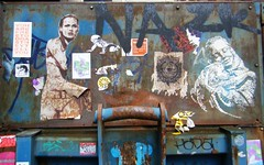 Manchester - street art on a skip (rossendale2016) Tags: collector refuse men dustbin dustbins collection waiting abandoned canopy rubbish office factory graffiti cartoon colour colourful posters stickers skip art street manchester