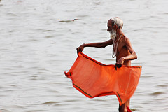 Saffron (kissoflif3) Tags: orange india man river person monk oldman bathing dip ganga sadhu saffron ganges allahabad lungi kumbhmela riverganga kumbhmela2013