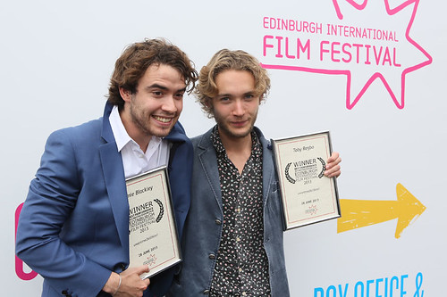 UWantMeToKillHim actors Jamie Blackley and Toby Regbo outside the Filmhouse after the Awards ceremony with their Award for Best Performance in a British Feature Film.