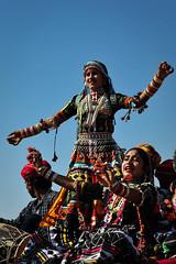 Jaisalmer, India, 2011 (marc_guitard) Tags: travel sky woman india festival 50mm costume clothing nikon women desert dancing great celebration traveling nikkor f18 jaisalmer thar rajasthan d700