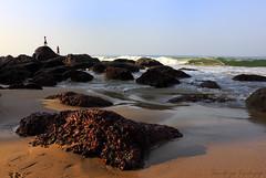 Anticipation (Sandhya Kashyap) Tags: morning sea beach boys golden coast sand rocks waves view stones goa sunny resort pools hours anticipation splash spectators carvings lash folding froth overlapping bogmolo
