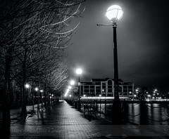 Damp And Lonely.. (Philip R Jones) Tags: nightphotography bw night dark lights highcontrast salfordquays le benches hdr lineoflights bwhdr