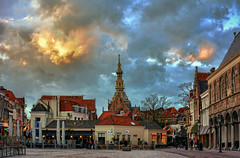 A great city is not to be confounded with a populous one. (Wim Koopman) Tags: old city roof red tower church architecture square place market center
