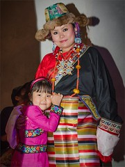 Tibetan woman and girl in Losar 2141 Prague (photo yanoya) Tags: prague tibet czechrepublic cz losar tibetanwoman tibetangirl losar2014 losar2141 tibetskýnovýrok